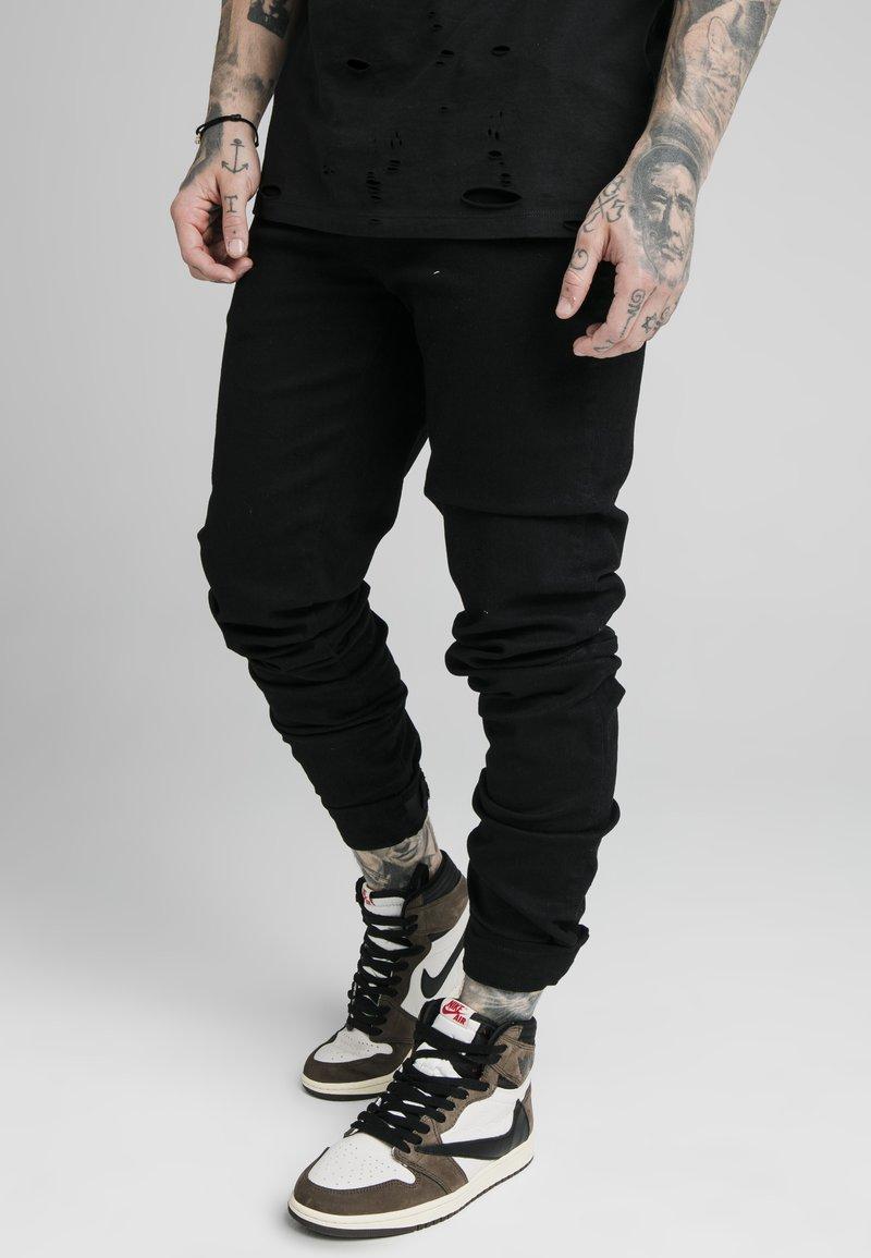 SIKSILK - ELASTICATED STRAP CUFF - Jeans slim fit - black