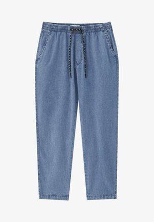 Zúžené džíny - light blue