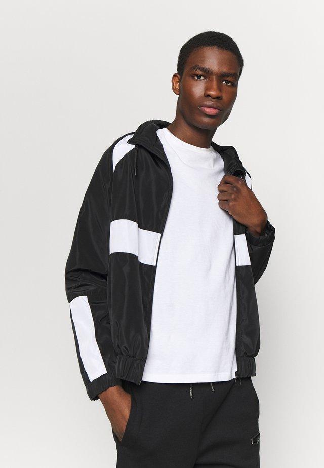 SENTERIO - Training jacket - black