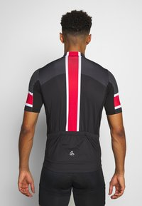 LÖFFLER - BIKE PACE - T-shirt z nadrukiem - black/red - 2
