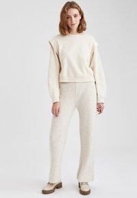 DeFacto - Trousers - beige - 0