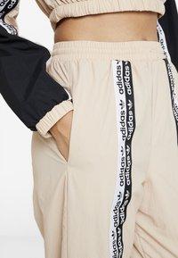 adidas Originals - TRACK PANTS - Trousers - ash pearl - 5