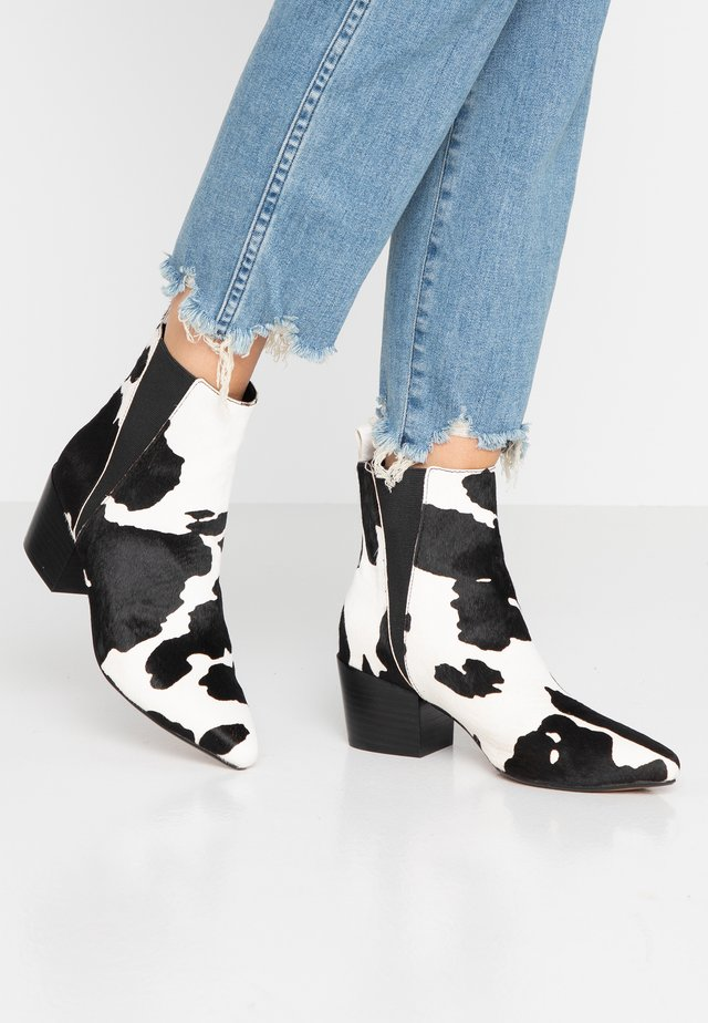 PUZZLE - Bottines - black/white