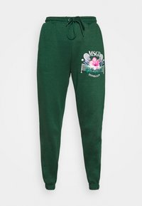 TENNIS GRAPHIC JOGGER - Tracksuit bottoms - green