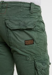 Alpha Industries - JET - Cargo trousers - dark petrol