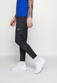 Nike Performance - SHIELD - Tracksuit bottoms - black/reflective silver - 3