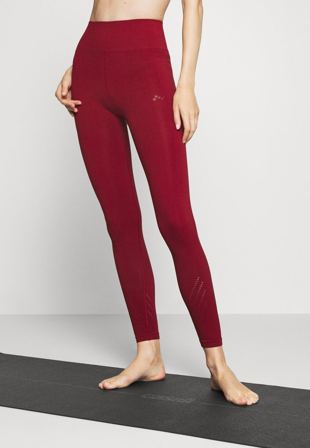 ONPJAVO CIRCULAR TIGHTS - Collants - sun dried tomato