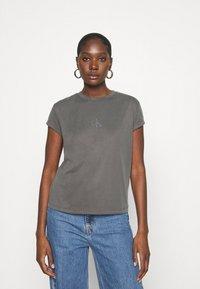 Calvin Klein Jeans - DRAPEY CAP SLEEVE  - Basic T-shirt - black - 0