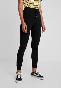 Topshop - MONO JEGGER - Leggings - Trousers - plain black - 0