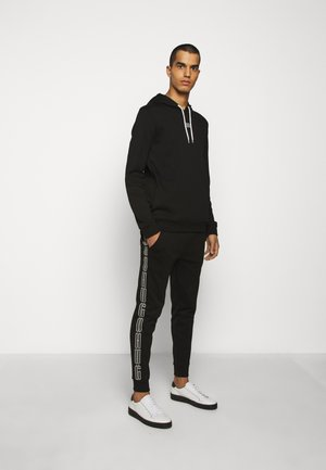 DAKY - Tracksuit bottoms - black