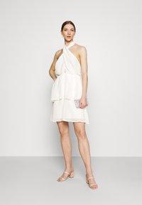 Gina Tricot - EXCLUSIVE MALVA HALTERNECK DRESS - Koktejlové šaty/ šaty na párty - white - 1