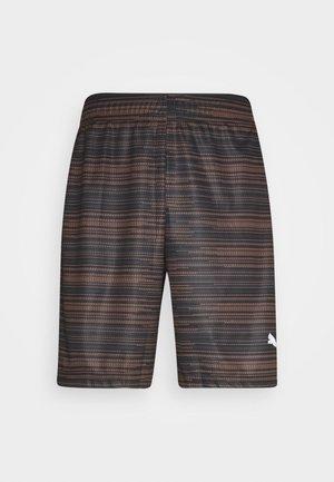 FTBLNXT GRAPHIC SHORTS - Sports shorts - black shocking/orange