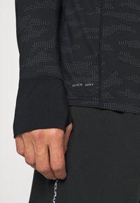 Endurance - ARTY REFLECTIVE MIDLAYER - T-shirt sportiva - black - 3