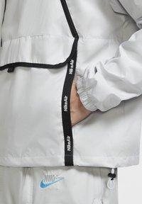 Nike Sportswear - Outdoor jacket - grey fog/black/laser blue - 5