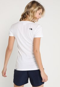 The North Face - SIMPLE DOME TEE - Basic T-shirt - white/black - 2