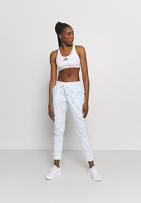 Cotton On Body - GYM TRACK PANTS - Tracksuit bottoms - baby blue - 1