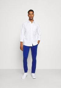 Tommy Jeans - SCANTON PANT - Trousers - blue - 1