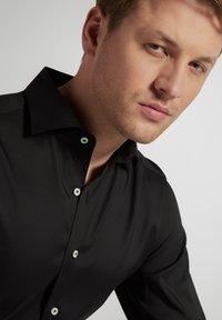 Eterna - SLIM FIT - Formal shirt - schwarz - 2