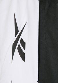 Reebok - VECTOR TRACK PANT - Pantalon de survêtement - black - 4
