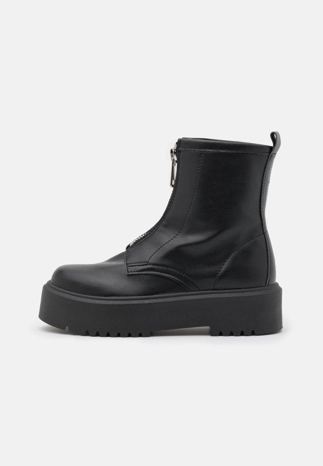 KASPER - Platform ankle boots - black