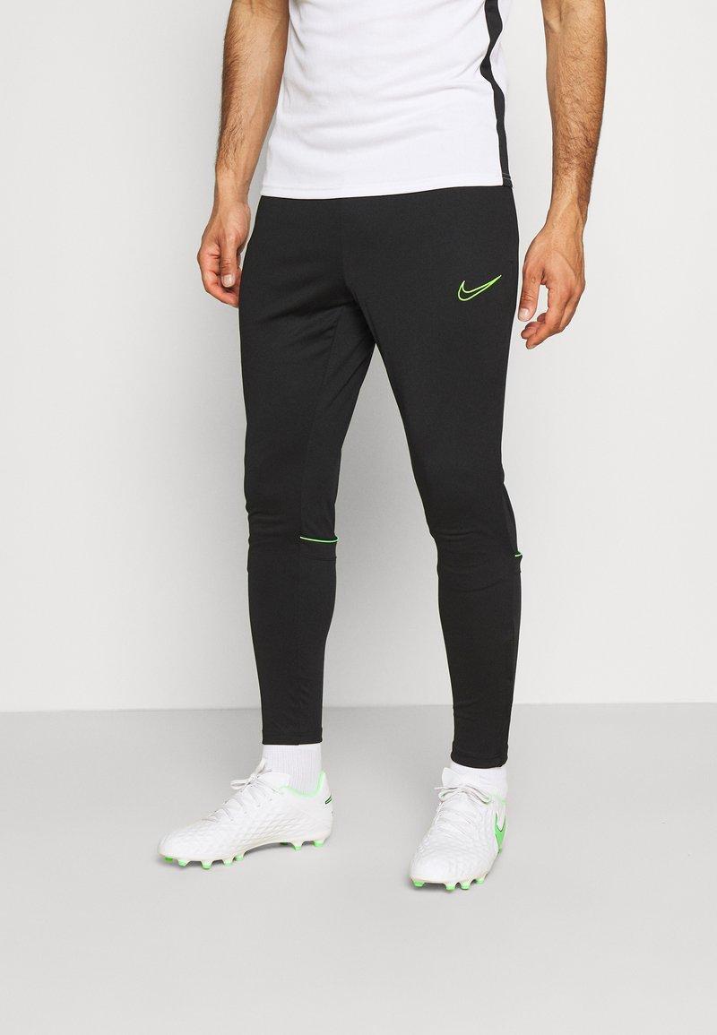 Nike Performance - ACADEMY 21 PANT - Tracksuit bottoms - black/green strike