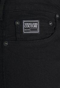Versace Jeans Couture - AMETIST  - Slim fit jeans - black - 7