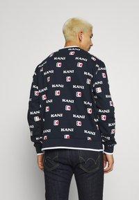 Karl Kani - Sweater - navy/white/red - 2
