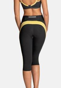 Anita - CAPRI  FITNESS - 3/4 sports trousers - gelb / anthrazit - 1