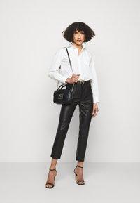 Pinko - SUSAN TROUSERS - Spodnie materiałowe - black - 1