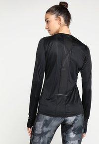 Reebok - TEE - Sports shirt - black - 2