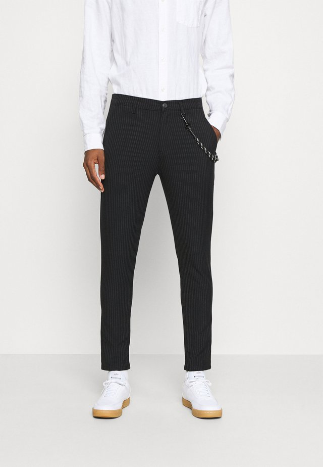 JIM - Trousers - insignia