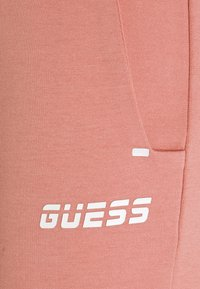 Guess - LONG PANTS - Tracksuit bottoms - vintage peony - 2