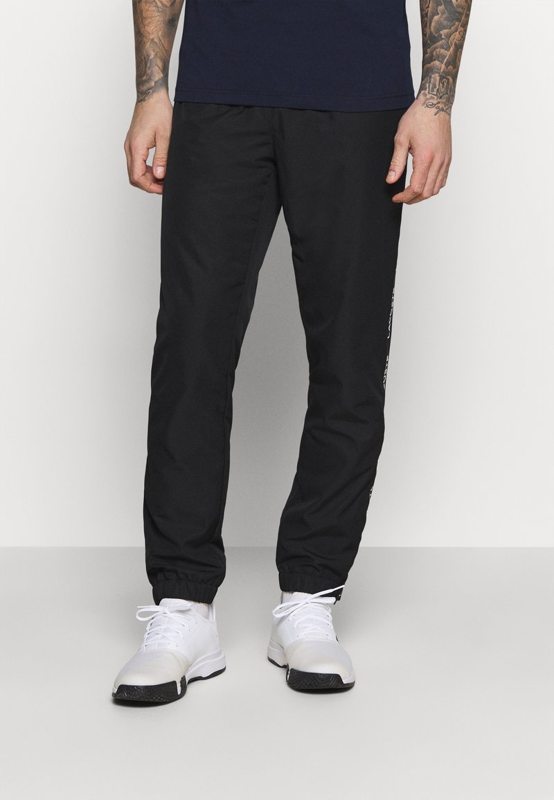 Lacoste Sport - TENNIS PANT TAPERED - Träningsbyxor - black/white