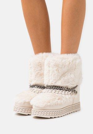 HASANA - Platform ankle boots - cream