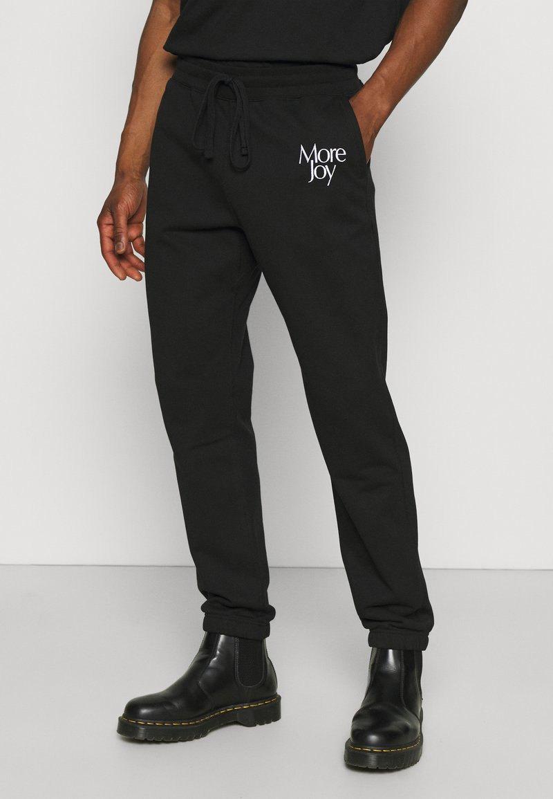 More Joy by Christopher Kane - MORE JOY EMBROIDERED CLASSSIC JOGGERS UNISEX - Tracksuit bottoms - black/white
