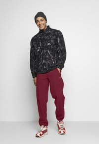 adidas Originals - WINTERIZED TRACK PANT - Trainingsbroek - coll burgundy/bold pink - 1