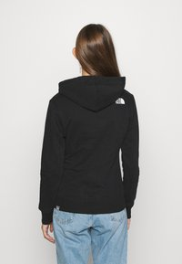 The North Face - STANDARD HOODIE - Hoodie - black