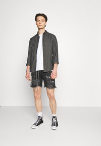 The Couture Club - BANDANA PATCH AND PAINT SPLAT CUT OFFS - Denim shorts - washed black - 1