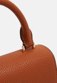 Calvin Klein - FLAP TOP HANDLE - Sac à main - brown - 3