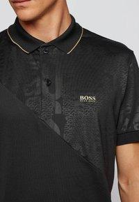 BOSS - Polo shirt - black - 3