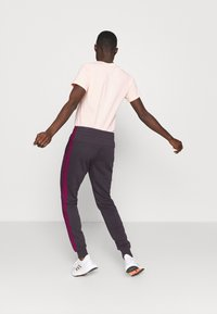 adidas Performance - PANT - Tracksuit bottoms - purple - 2