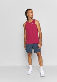 Nike Performance - RISE TANK - Camiseta de deporte - noble red - 1
