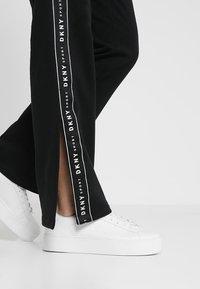 DKNY - TRACK PANT W/SIDE SLIT - Tracksuit bottoms - black - 3