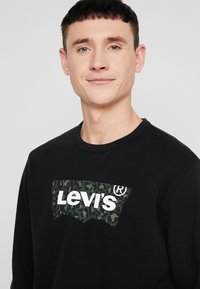 Levi's® - GRAPHIC CREW  - Sweatshirt - mineral black