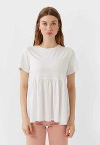 Stradivarius - BASIC-PEPLUM - T-Shirt print - white - 0