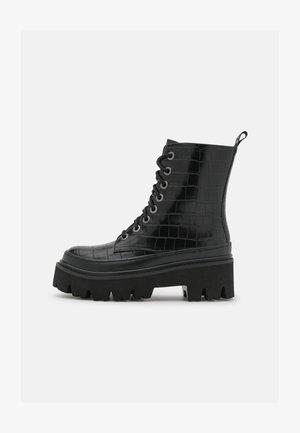 WELT  - Platform ankle boots - black