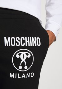MOSCHINO - TROUSERS - Tracksuit bottoms - black - 4