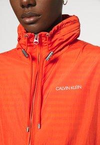 Calvin Klein - PACKABLE JACKET - Summer jacket - fiesta - 6