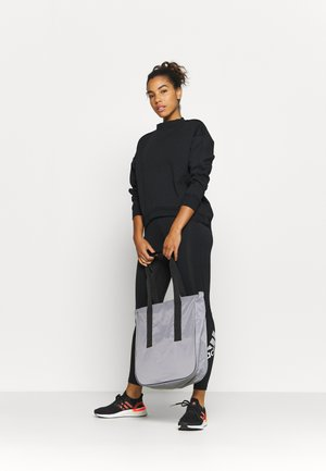 TOTE - Sports bag - glow grey/black/white