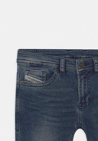 Diesel - THOMMER UNISEX - Slim fit jeans - blue denim - 2